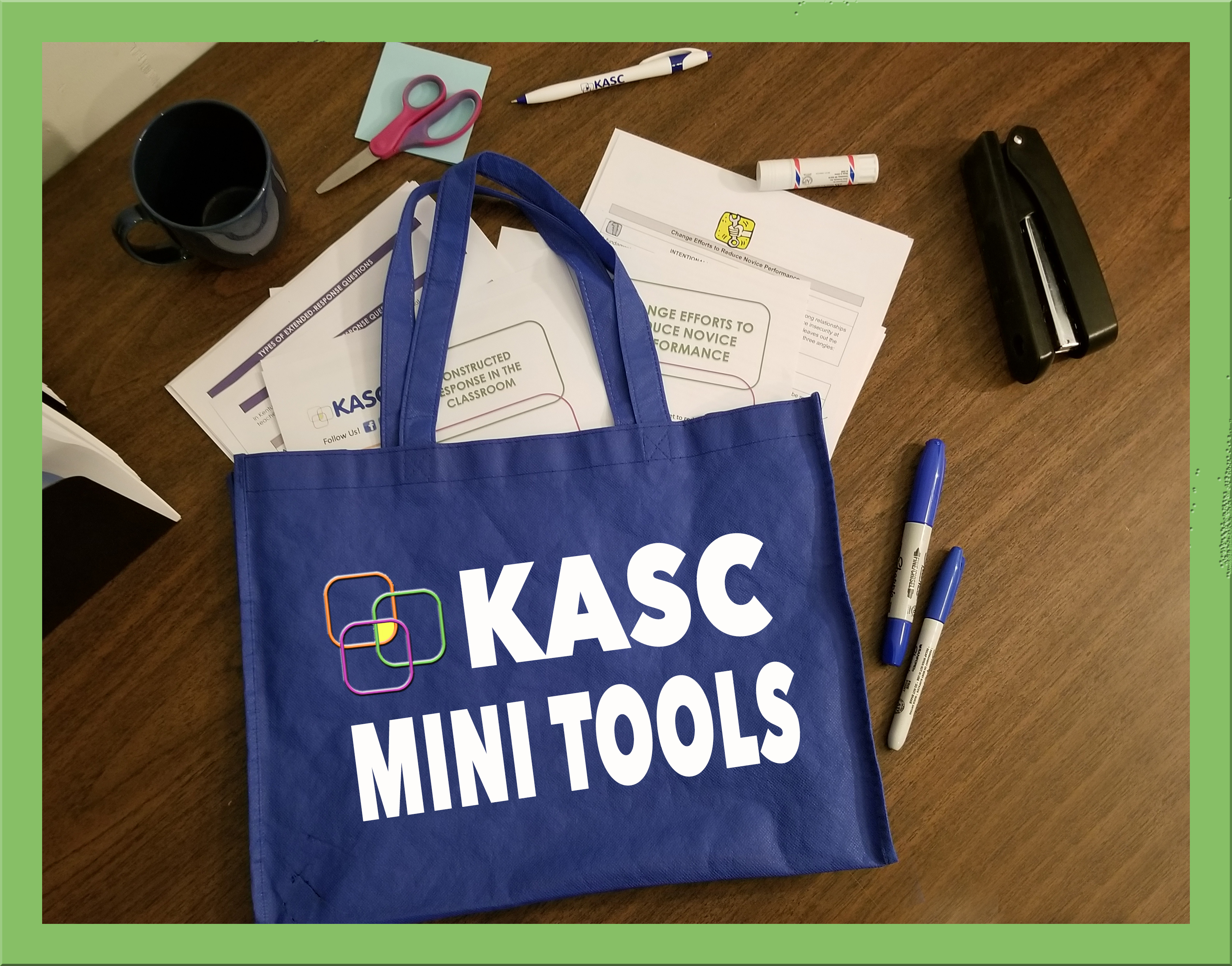 Blue teacher bag with mini tools and desk items